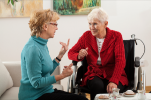 caregiver talking to her patient