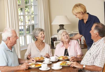 senior couples enjoying meal together
