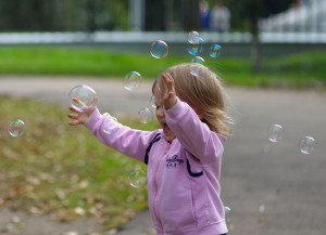 Little Girl Toddler Chasing Bubbles
