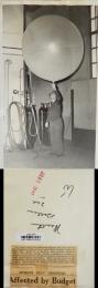 1941--Man Holding a Helium-Filled Radiosonde Balloon, Spokane, WA