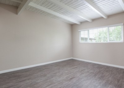 Empty bedroom with exposed white beams