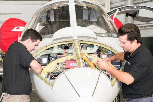 Maintenance Team Working on Engine Exterior