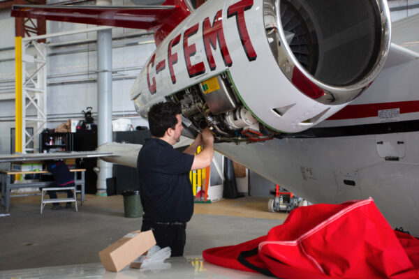 Maintenance Team Working on Learjet Exterior