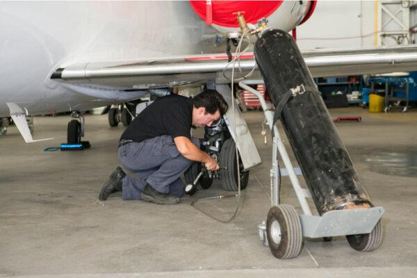 Maintenance Team Working on Wheel