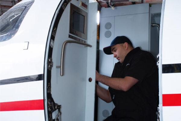 Maintenance Team Working on interior learjet