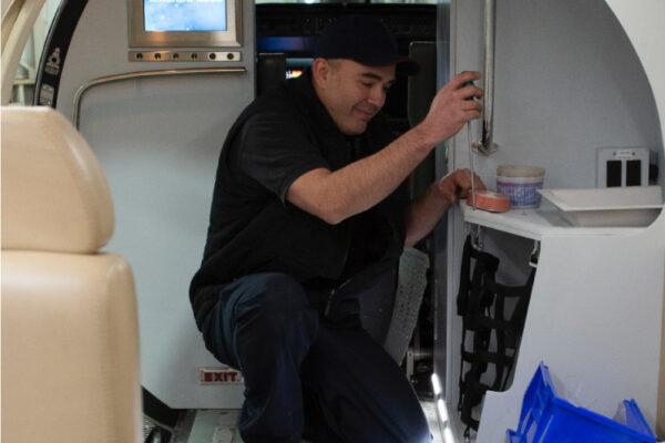 Maintenance Team Working on interior plane