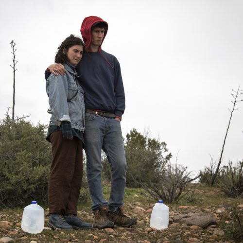 """IMPERIAL COUNTY, CA 03/10/2019:  Amba Guerguerian and Wes Markusfeld were part of a Border Angels team of volunteers that carried gallons of water into the Imperial Valley in southeastern Southern California near the Mexico border and hid the plastic bottles scattered along trails that undocumented migrants often take after crossing into the California.  Along the trails, discarded items such as makeshift foot coverings migrants use to avoid leaving footprints could be seen as well as other discarded clothes and remnants of campfires. The conditions here are extreme, often were windy and cold at night, and extremely ward during the daytime. Border Angels is a nonprofit that has been leading humanitarian efforts such as """"water drops"""" in the desert for migrants for over 20-years. In 2019, two border aid volunteers were sentenced to 15 months of probation, must pay fines for dropping off water and food intended for migrants crossing through a protected desert area in southern Arizona."""