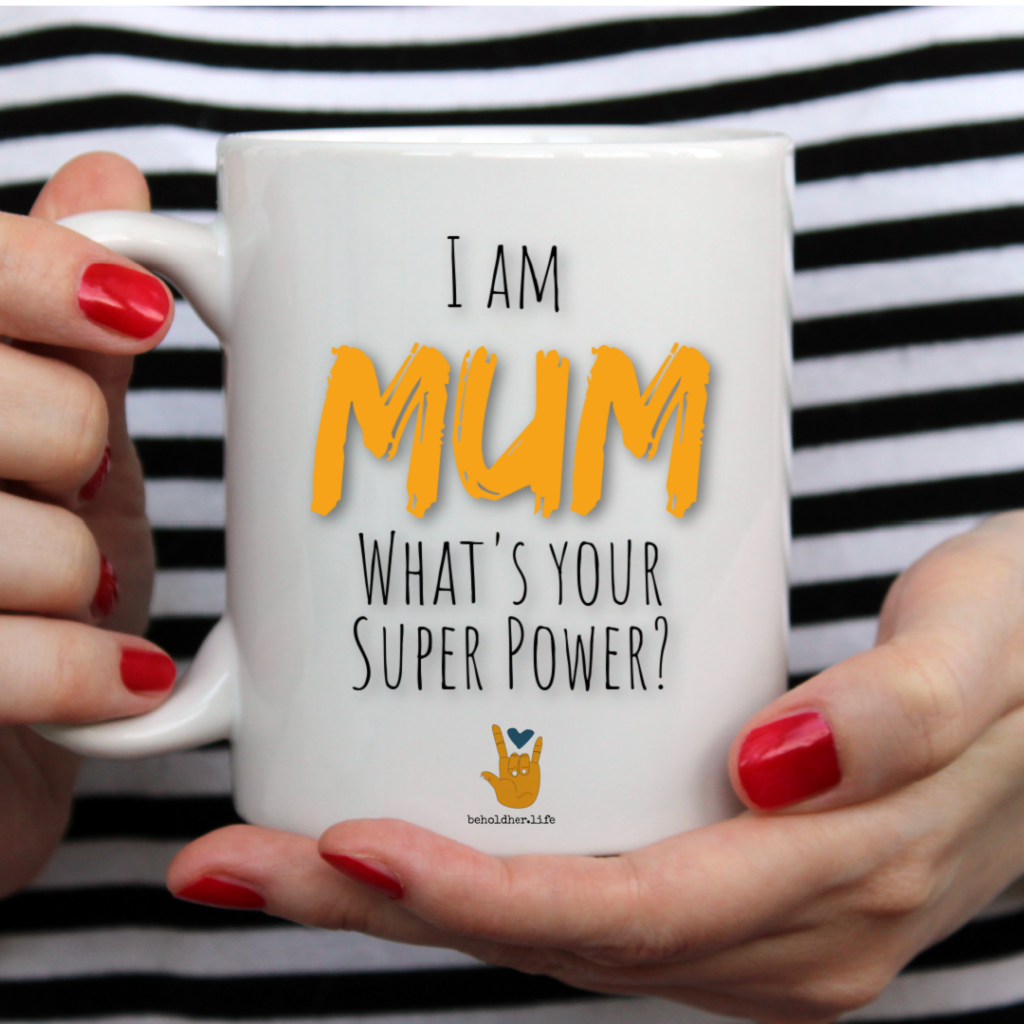beholdher.life blog no 7 the mother guilt effect i am a mum what's your super power mug held by woman with red nails and black and white striped shirt