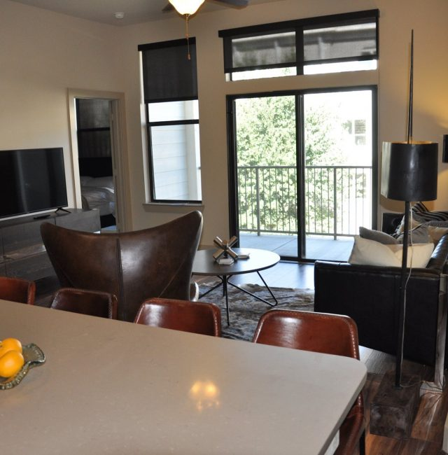 Kitchen view of living room from the Texas design at Premier Patient Housing.