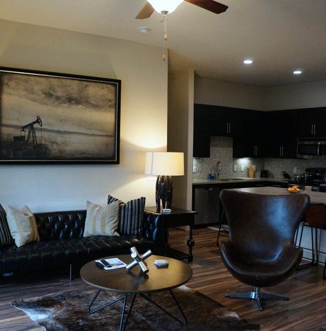 Living room with couch and coffee table, from the Texas design at Premier Patient Housing.