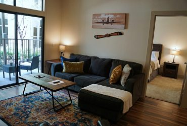Second bedroom view of living room of the Ohio design at Premier Patient Housing.