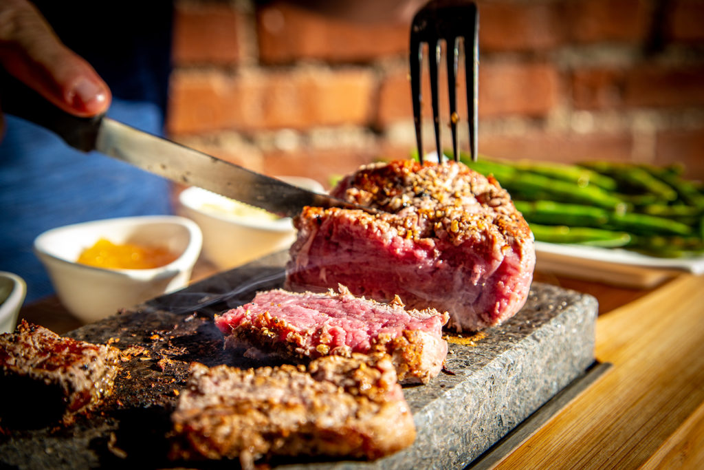 North Shore Taverns Steak cooking on a hot stone