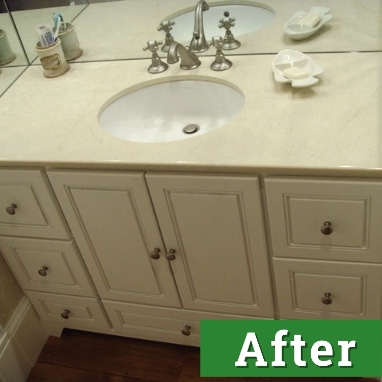 a white bathroom vanity and sink