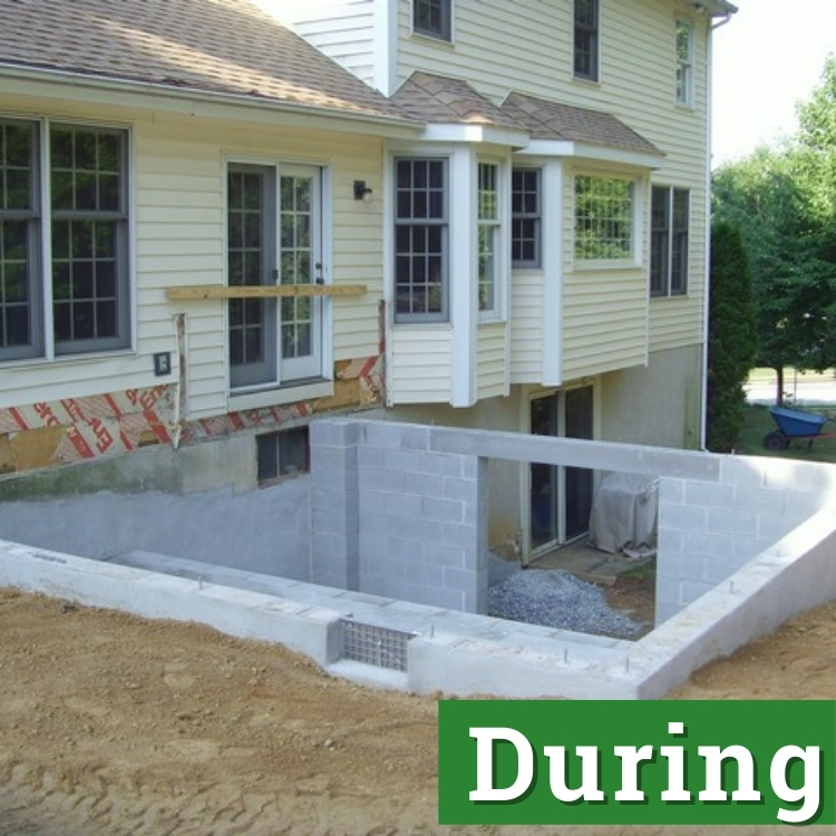 a newly built foundation with a basement made of grey construction bricks and cement