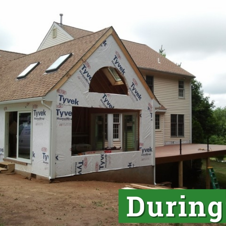 sheets of tyvek of an unfinished sunroom addition