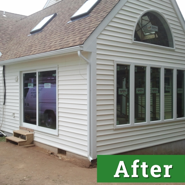 new windows and sliding glass doors of a new sunroom addition