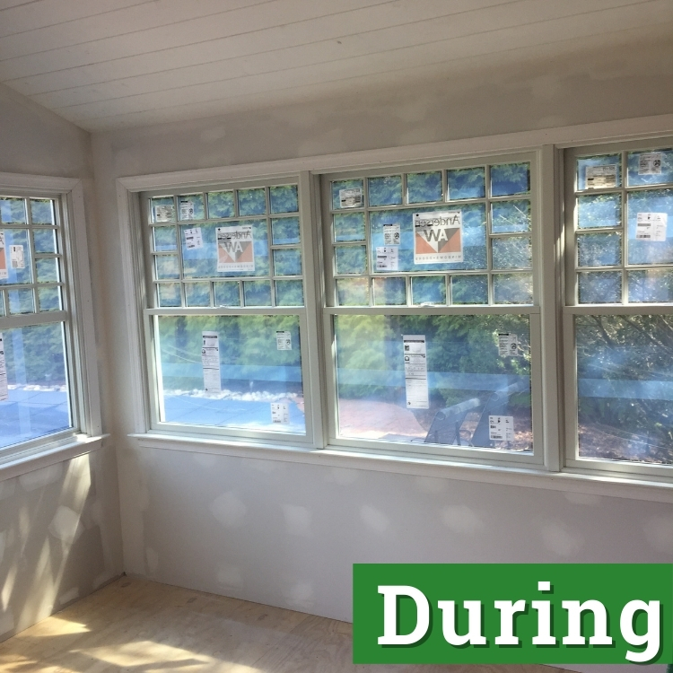 light filters in through windows of a newly built sunroom