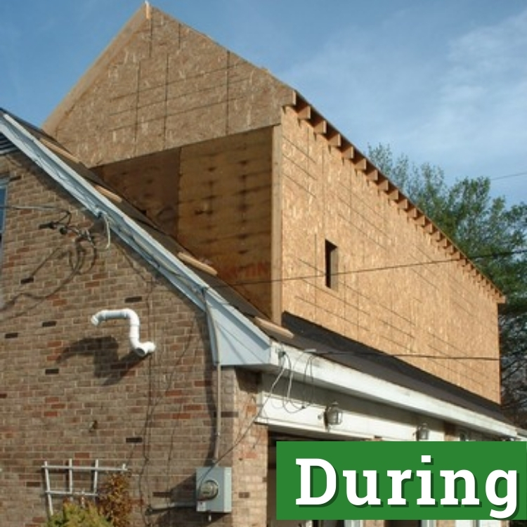 the wooden structure of a newly built second floor addition