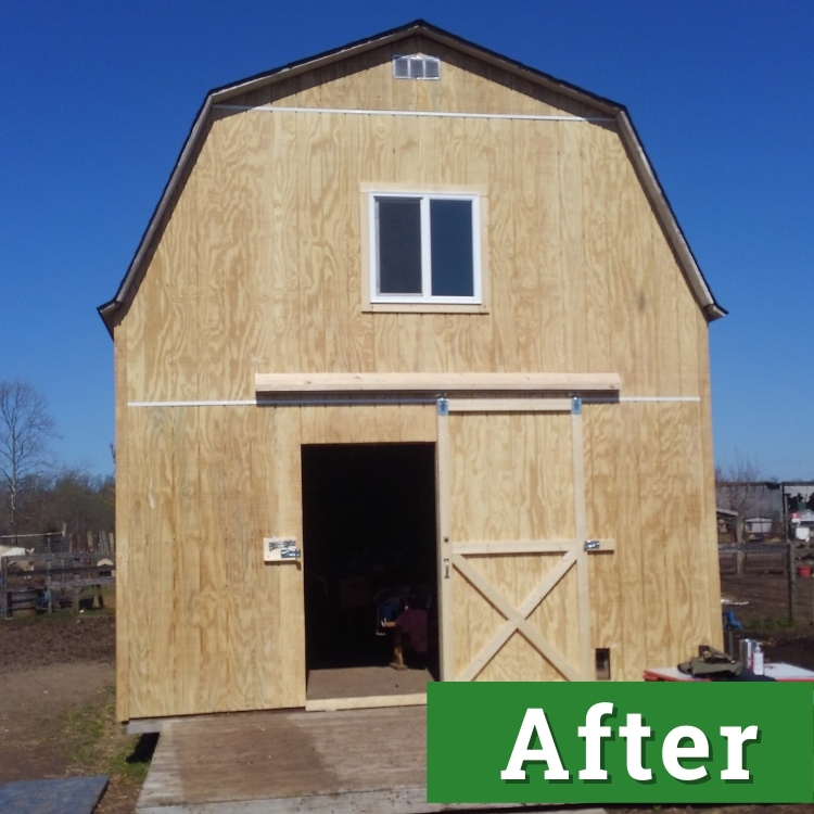 the open door of a newly constructed barn