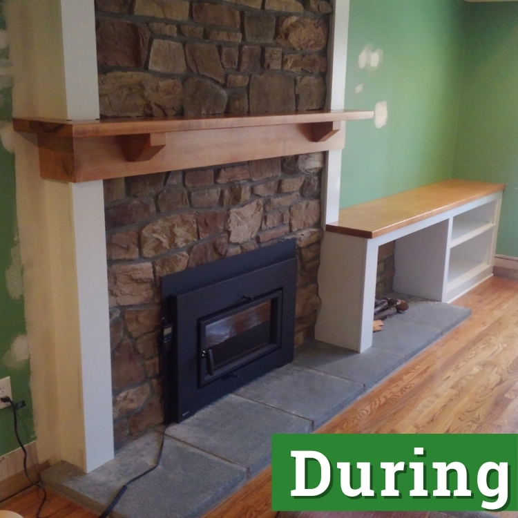a stone fireplace with a custom built wooden mantel