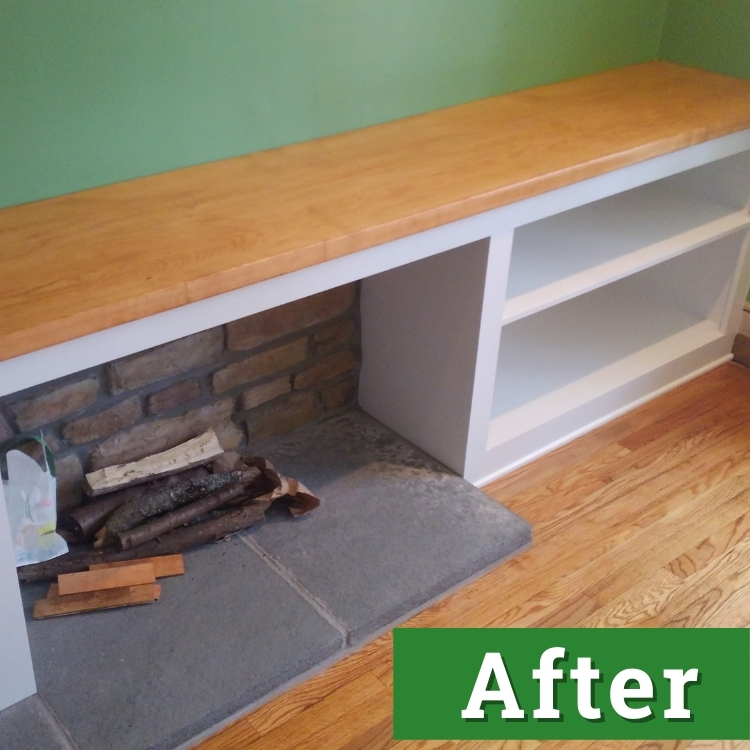 custom built white shelving with a wooden counter