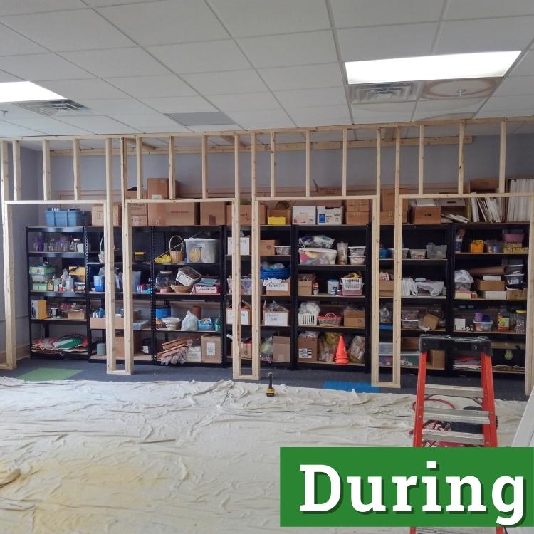 black shelves sit behind framing of a custom built storage project