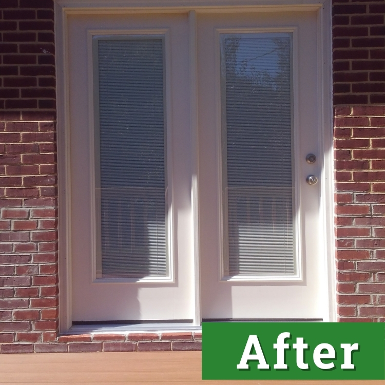 white double doors on a brick home