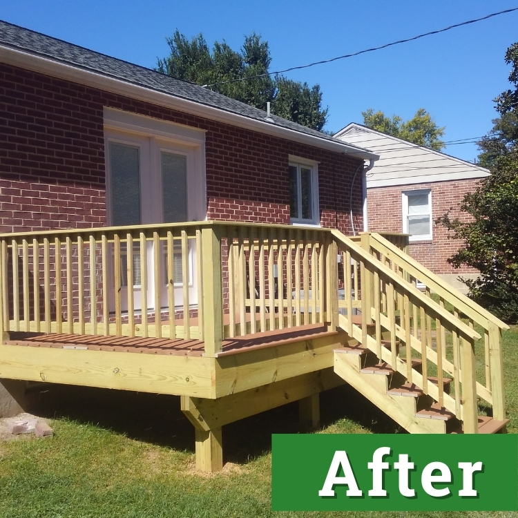 a custom built deck made with fresh wood attached to a brick house