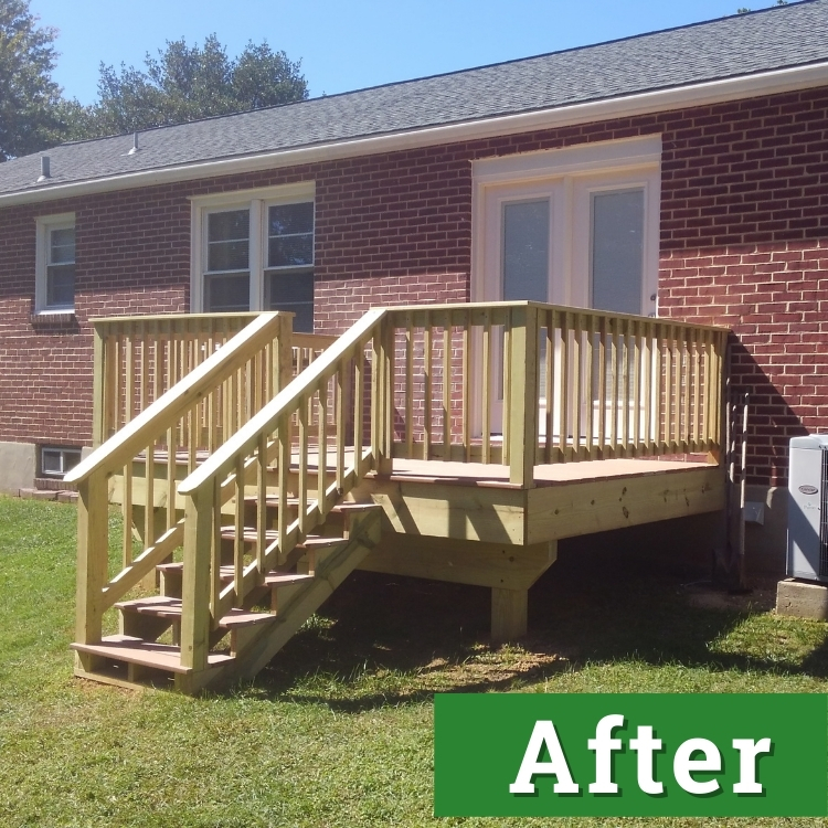 a custom built deck with stairs and a railing on the back of a brick home
