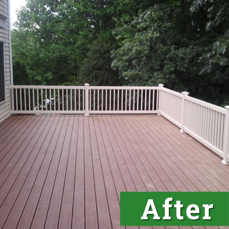 a newly built deck made with composite board and white railings