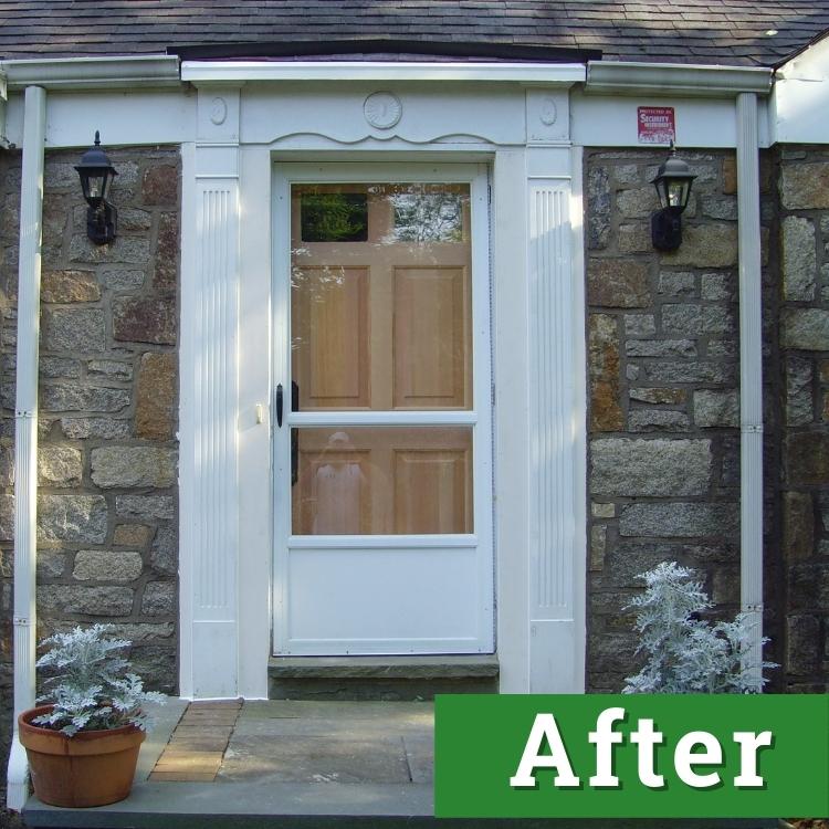 a new wooden door sits behind a white storm door