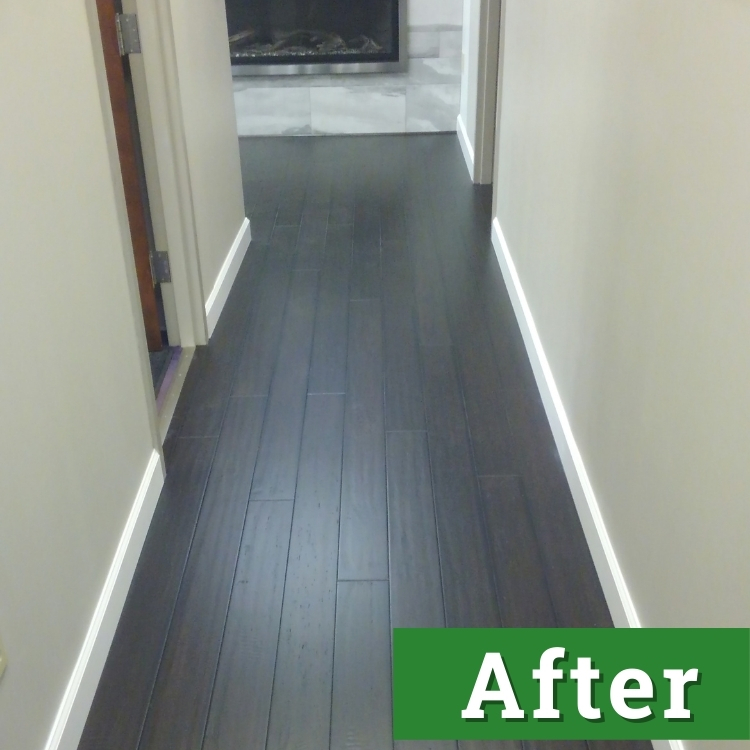newly installed dark wood laminate flooring extends down a long hallway