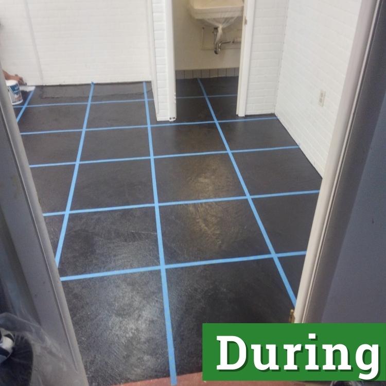 blue tape crisscrosses over a black floor