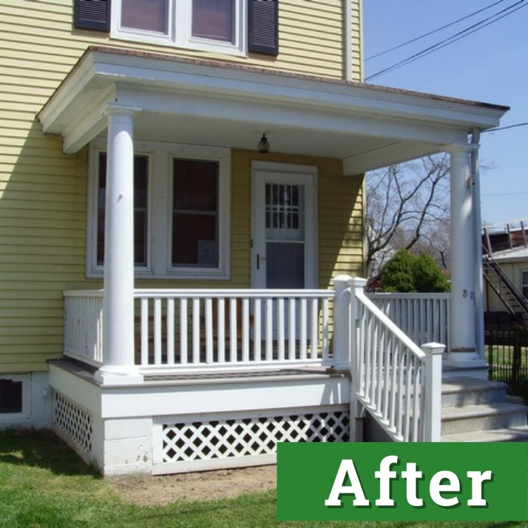 a newly renovated front porch with white railings and laticework