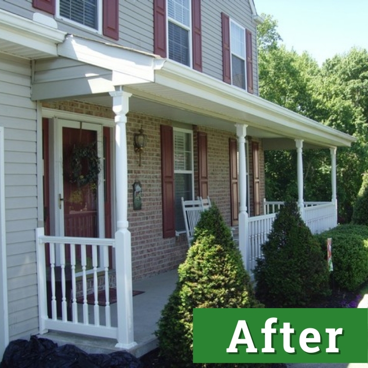 a newly installed front porch with white railings behind green shrubbery