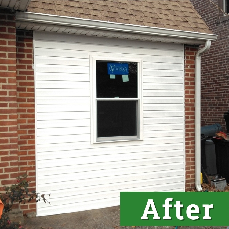 white siding and a window of a converted garage