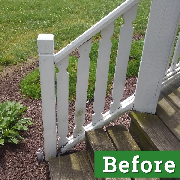 a white railing with mold stained slats