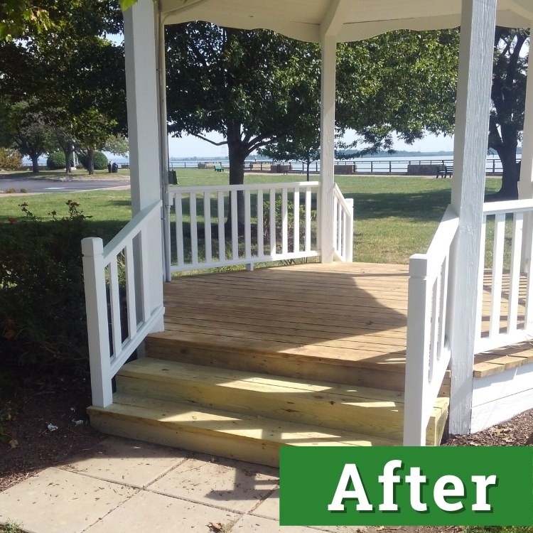 new wooden flooring and new white paint of a restored gazebo