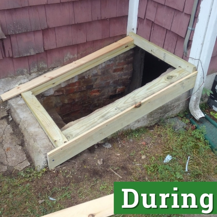new framing of a ground level basement door
