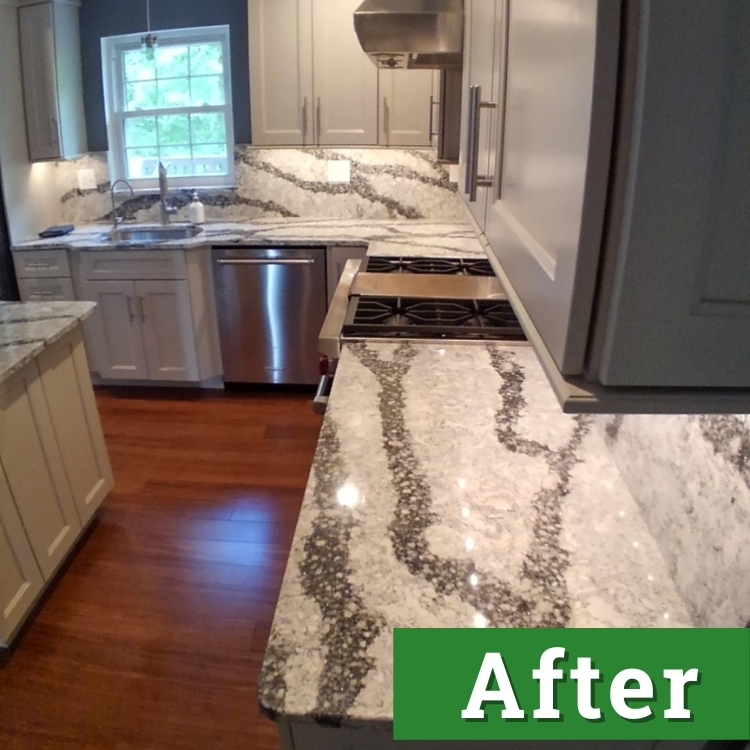 white and black marble countertops and stainless steel appliances