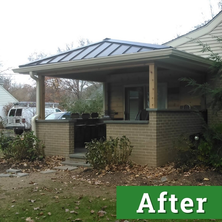 a newly built patio with a partial enclosure and roof