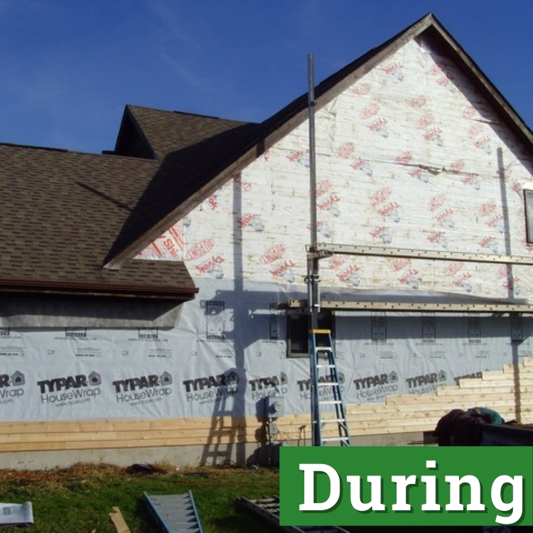 typar housewrap and tyvek on the side of a home under construction