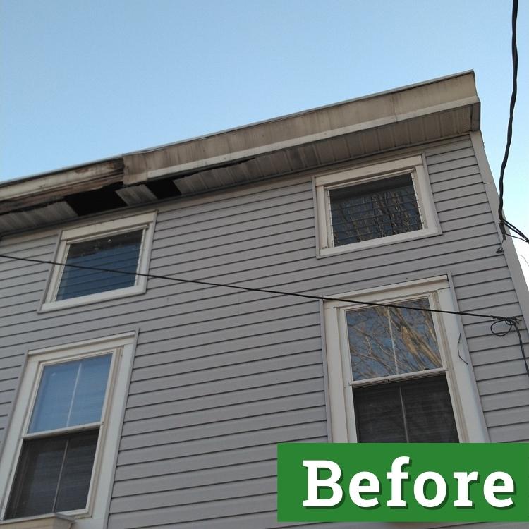 gutter damage on a light gray house