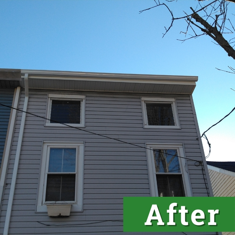 new gutters on a light gray house