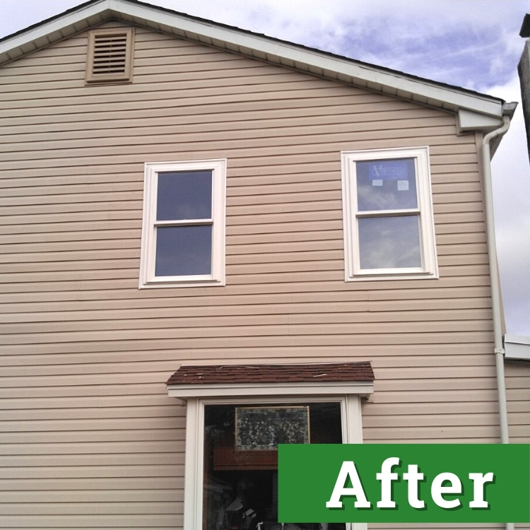 new windows and siding on a brown house