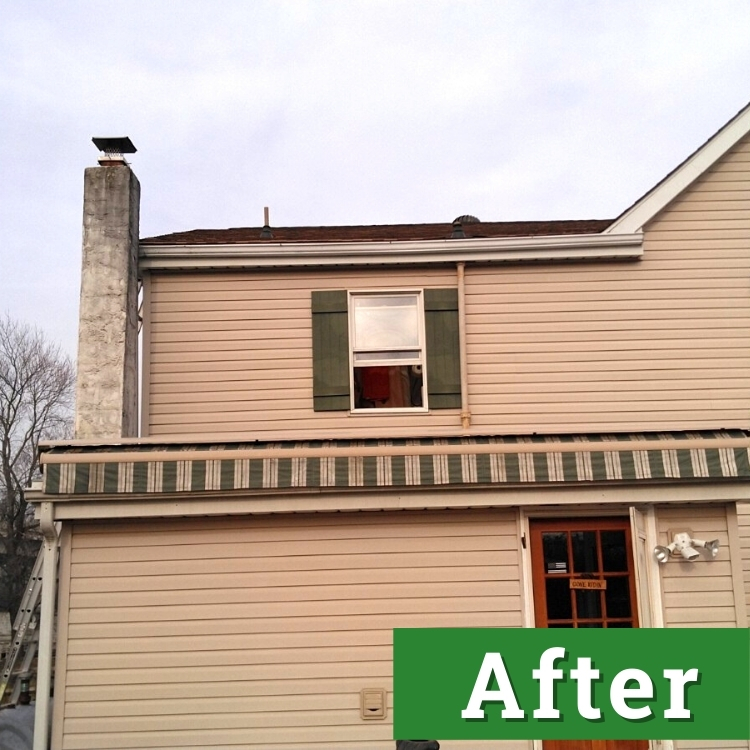a new window with shutters on a brown house