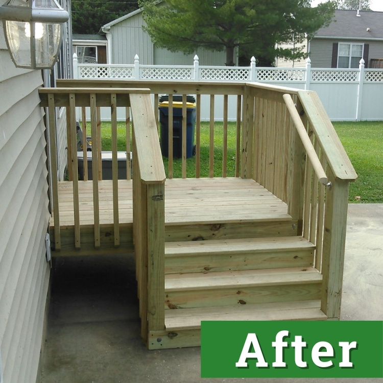 a small newly built deck on the side of a house