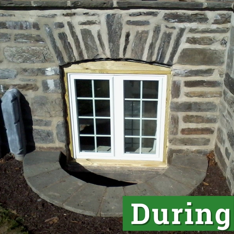 a basement egress window under construction