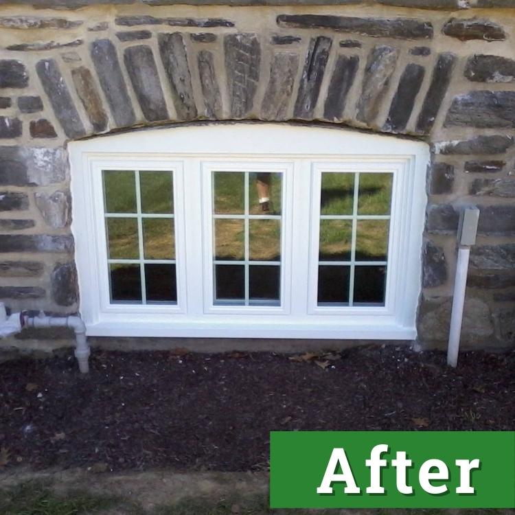 a white three pane basement window