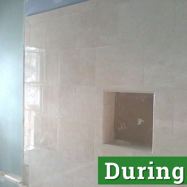 a shower wall in the process of being installed